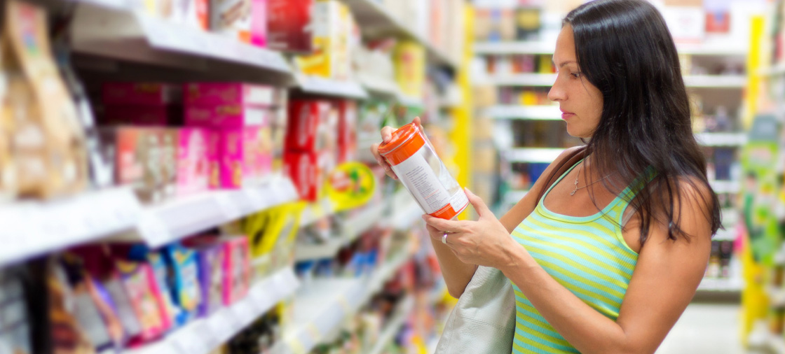 woman looking disturbed while reading product information